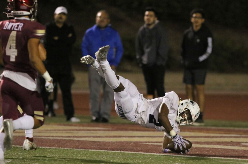 Carlsbad's Matt Moore hits paydirt after catching a 56-yard touchdown pass in Friday night's win over Mission Hills.