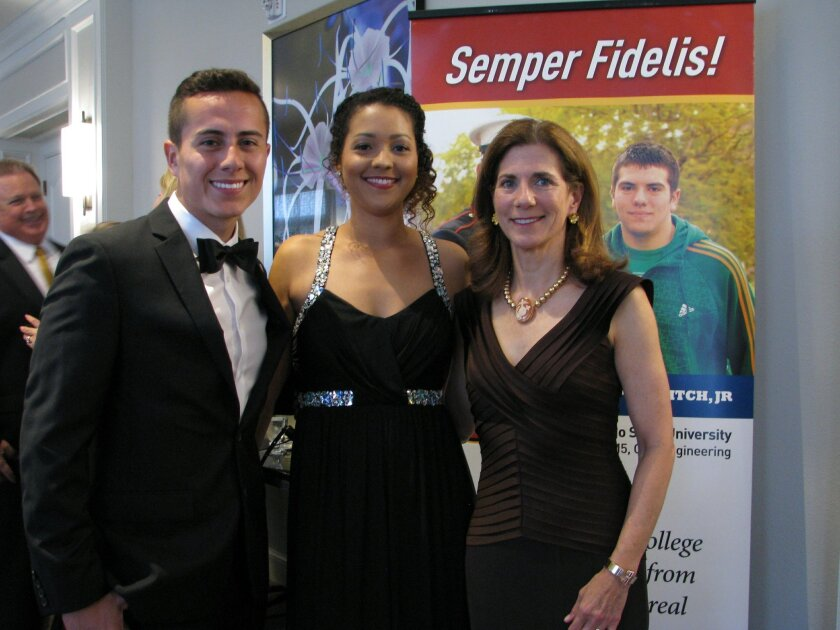 L-R: Scholarship recipients Andrew Coba and Brittany Brown with Marine Corps Scholarship Foundation President and CEO Margaret B. Davis at the foundation's San Diego Awards Dinner. Photo by Jeanne McKinney