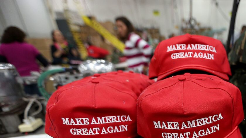 """Workers stitch """"Make America Great Again"""" hats in Carson in 2015."""