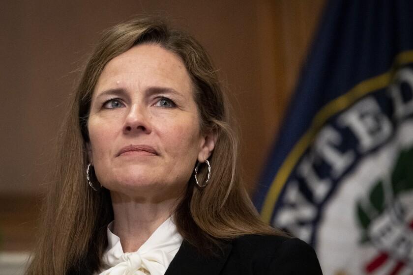 Supreme Court nominee Judge Amy Coney Barrett, meets with Sen. Joni Ernst, R-Iowa, not shown, Thursday, Oct. 1, 2020, at the Capitol in Washington. (Caroline Brehman/Pool via AP)