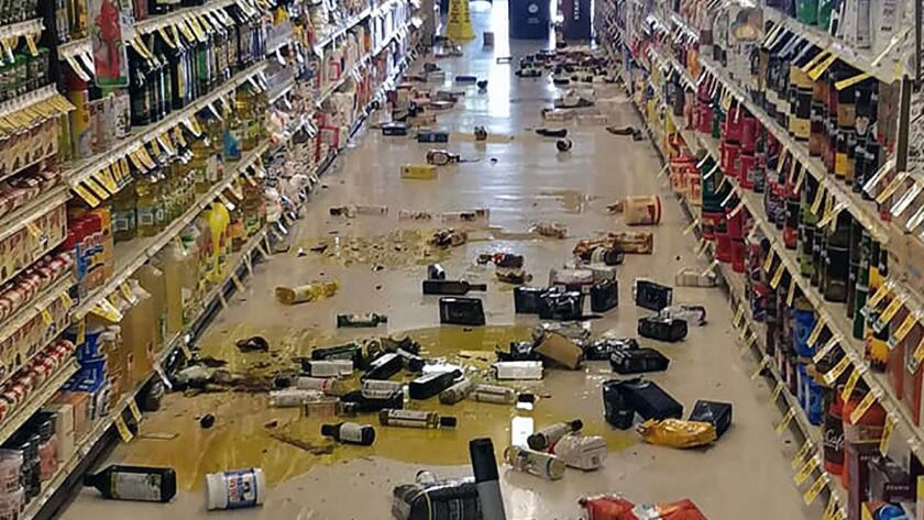 Broken bottles and other goods are seen in a store in Lake Isabella, Calif., after a 6.4 magnitude quake hit Southern California on Thursday morning.