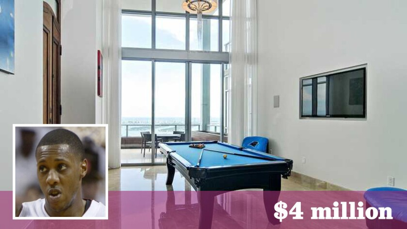 Heat guard Mario Chalmers' Miami condominium consists of two merged units within the Marquis Residences with vaulted interiors, floor-to-ceiling glass and a marble staircase.