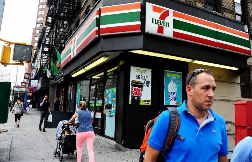 Federal authorities have charged nine 7-Eleven store owners and operators in the New York area and in Virginia of hiring illegal immigrants, paying them using fake Social Security numbers and stealing a portion of their wages.