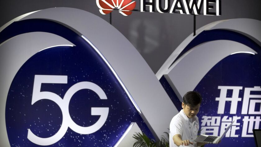 A display for 5G wireless technology from Chinese technology firm Huawei at the PT Expo in Beijing.