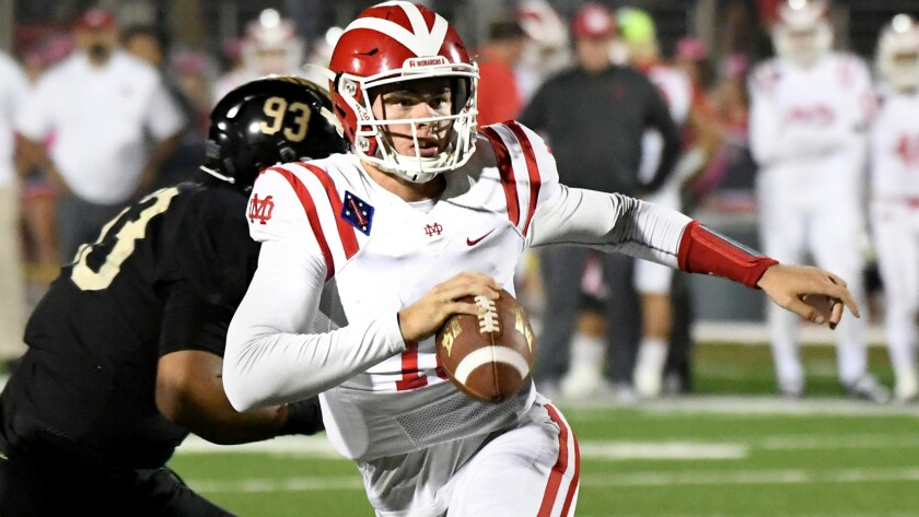 TORRANCE, CALIFORNIA OCTOBER 13, 2017-Mater Dei quarterback JT Daniels avoids the St. John Bosco def