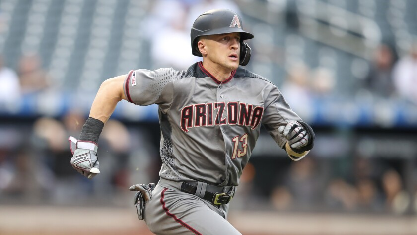 FILE - In this Sept. 12, 2019 file photo Arizona Diamondbacks' Nick Ahmed runs to first during the sixth inning of a baseball game against the New York Mets in New York. The Diamondbacks have agreed to a $32.5 million, four-year deal with Ahmed. The 29-year-old Ahmed avoids his final year of salary arbitration with the deal, which keeps him with the team through 2023. (AP Photo/Mary Altaffer, file)