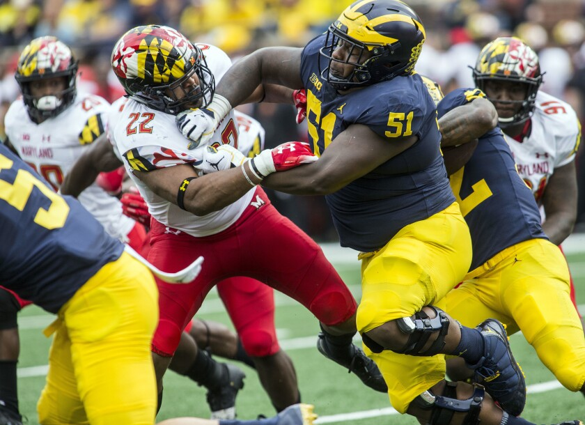 Michigan center Cesar Ruiz (51) is a borderline first-round pick in the upcoming NFL Draft.