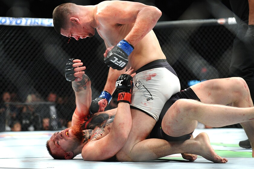 LAS VEGAS, NEVADA MARCH 5, 2016-Nate Diaz takes down Connor McGregor in UFC 196 Welterweight Bout Saturday at the MGM Grand Garden Arena. Nunes wins by unanimous decision. (Wally Skalij/Los Angeles Times)