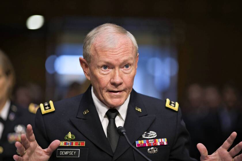 Army Gen. Martin Dempsey, chairman of the Joint Chiefs of Staff, testifies before the Senate Armed Services Committee during his reappointment hearing. Dempsey refused to offer his personal views on launching airstrikes in Syria to help the rebels, saying the president would make the final decision on use of force.