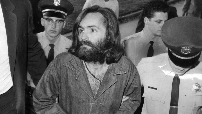 Charles Manson is escorted to court for a preliminary hearing in December 1969.