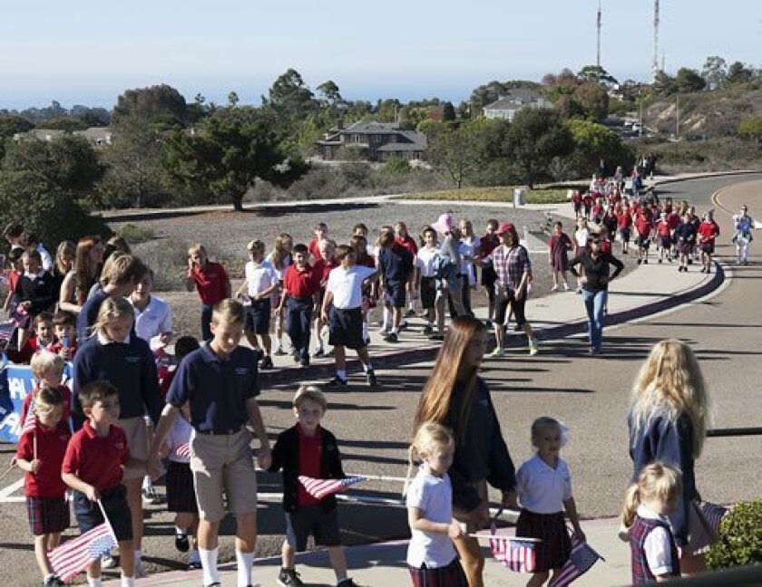 More than 200 students and staff take a 2013 Veterans Day walk from All Hallows Academy in La Jolla to the Mount Soledad Veterans Memorial, located about 1 mile from the school.