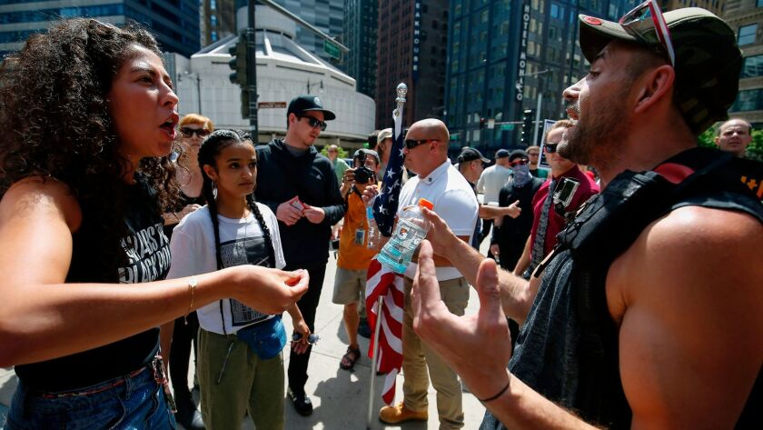 A Muslim supporter, left, argues with a demonstrator at the March Against Sharia protest in Chicago