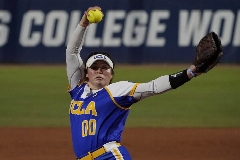 UCLA's Rachel Garcia pitches in the first inning.