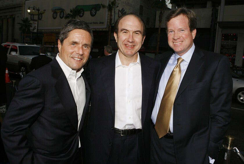 Viacom has extended the employment agreement of Chief Operating Officer Tom Dooley, right, through December 2018. He is shown in 2007 with Paramount Chief Executive Brad Grey, left, and Viacom CEO Philippe Dauman.