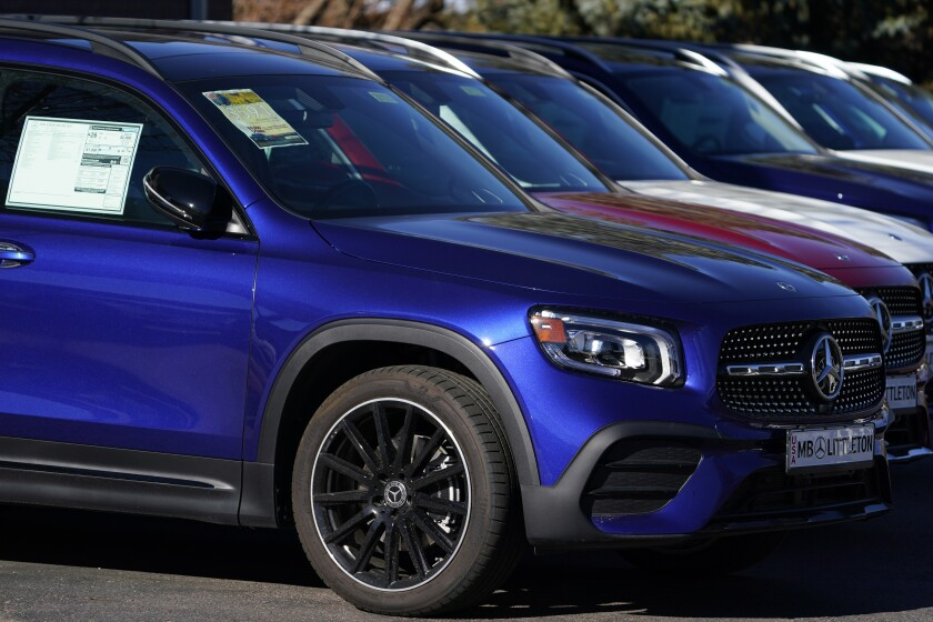 In this Nov. 15, 2020 photo, a long row of unsold 2020 GLB250 sports-utiity vehicles sits at a Mercedes Benz dealership in Littleton, Colo. The brand is the among many that have shut down their subscription services. (AP Photo/David Zalubowski)