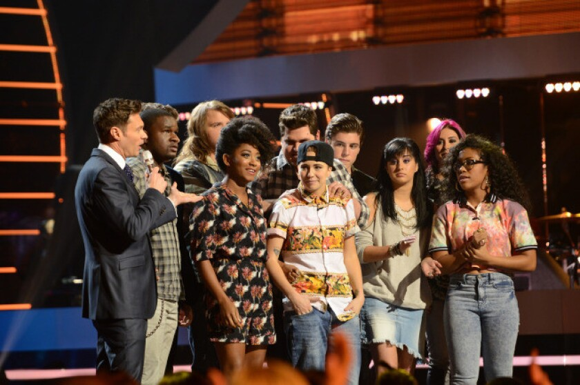 MK Nobilette (center) is reluctantly sent home on 'American Idol.'