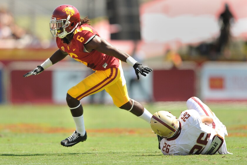 USC's Josh Shaw celebrates his tackle of Boston College's David Dudeck during a game at the Coliseum on Sept. 14, 2013.