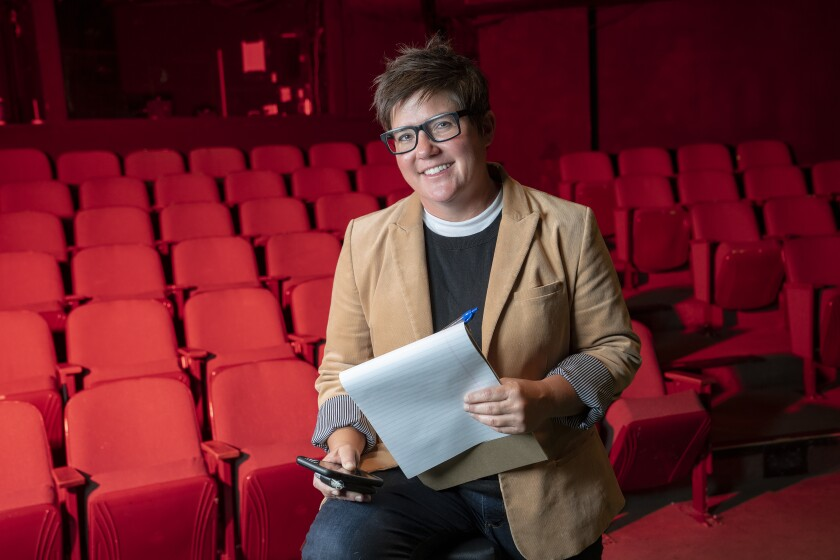 Jenny Case, sitting on stage, is the managing director of Diversionary Theatre, the third oldest LGBTQ theater in the nation and in its 34th season.