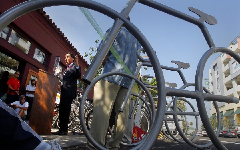 Councilman Todd Gloria speaks during the press conference and ribbon cutting ceremony unveiling a new bike corral in North Park at 30th Street and North Park Way in San Diego, California.