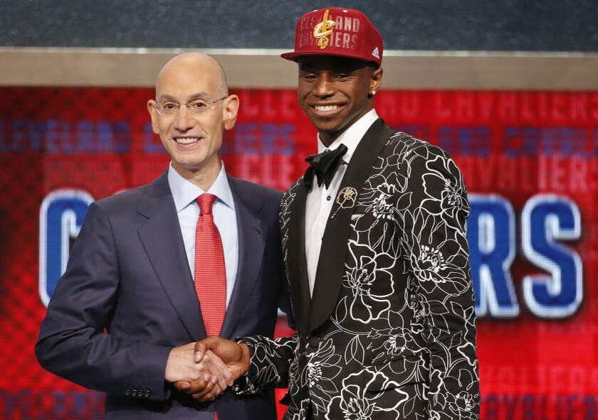 NBA Commissioner Adam Silver, left, congratulates Andrew Wiggins of Kansas who was selected by the Cleveland Cavaliers as the number one pick in the 2014 NBA draft.