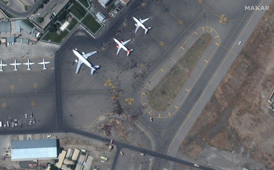 This satellite photo shows a large number of  people on the tarmac at Kabul's international airport.