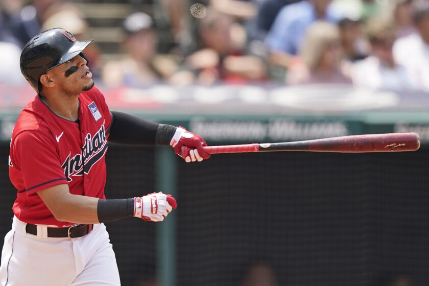 Cleveland Indians' Cesar Hernandez watches his two-run home run in the third inning of a baseball game against the St. Louis Cardinals, Wednesday, July 28, 2021, in Cleveland. (AP Photo/Tony Dejak)
