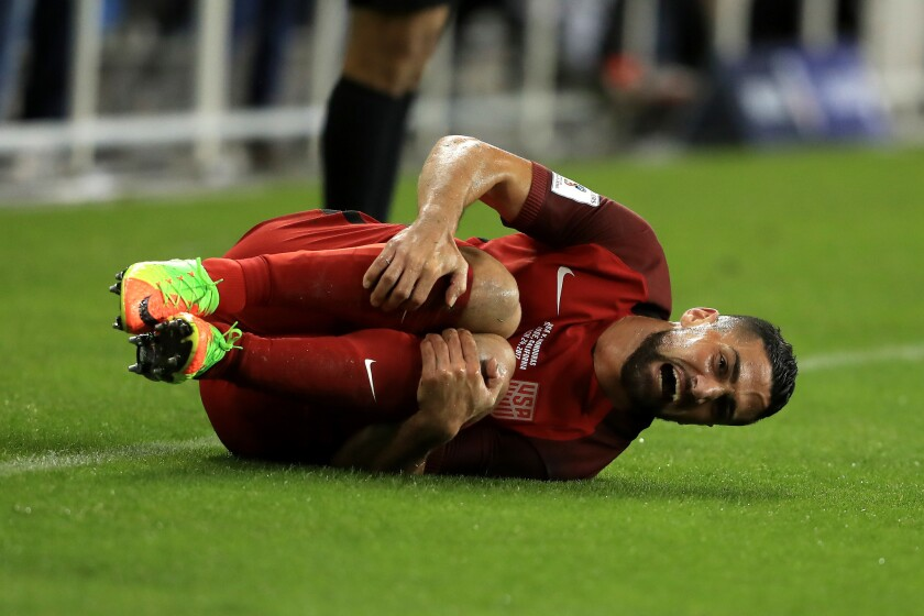 Sebastian Lletget reacts after being tripped by Honduras's Ever Alvarado during their FIFA 2018 World Cup Qualifier at Avaya Stadium on March 24, 2017 in San Jose.
