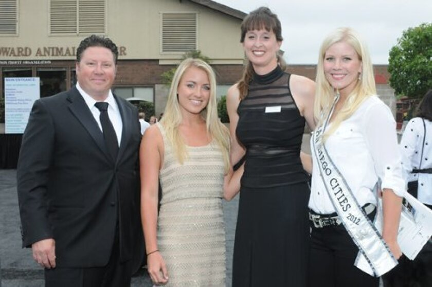 Auctioneer Joel Burlingame, Sara Parma of the HW Special Events and Sponsorship committee, Christen Hanley of the HW Silent Auction committee, Miss San Diego Cities 2012 Kayla Ross