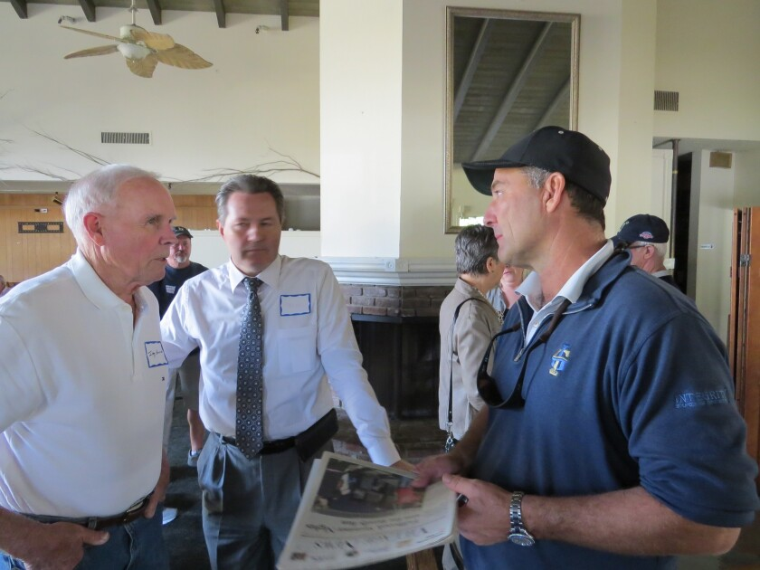 Jade Work (right), the new owner of the Fallbrook Golf Club property, meets with residents of the area to discuss his wine making plans for the land.
