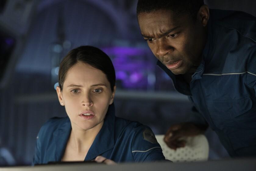 """Felicity Jones and David Oyelowo in the movie """"The Midnight Sky."""""""