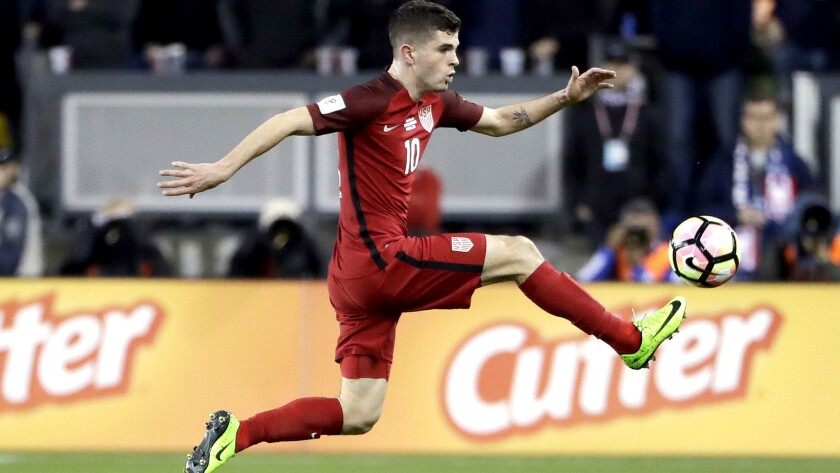 Christian Pulisic receives a pass during the U.S. win over Honduras.