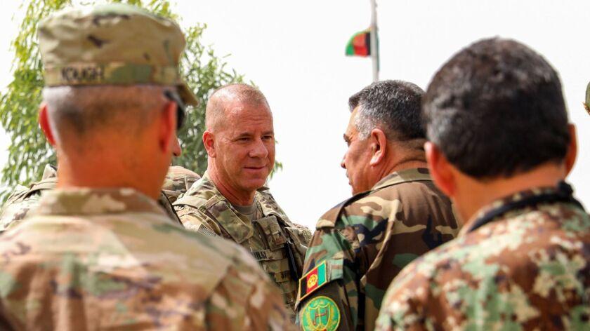 U.S. Army Brig. Gen. Jeffrey Smiley talks with Afghan Army Brig. Gen. Abdul Rahman Parwani on July 5, 2018.