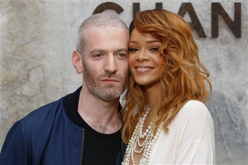 Singer Rihanna, right, and Mel Ottenberg pose for photographers as they arrive to for Chanel's Haute Couture Fall-Winter 2013-2014 collection, presented Tuesday, July 2, 2013 in Paris. (AP Photo/Francois Mori)