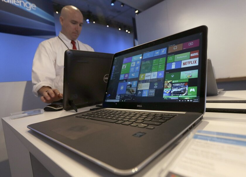 FILE - In this April 29, 2015, file photo, a Dell laptop computer running Windows 10 is on display at the Microsoft Build conference in San Francisco. In a statement issued to the BBC on May 24, 2016, Microsoft denied claims that it was forcing users of older Windows versions to upgrade to Windows 10. (AP Photo/Jeff Chiu, File)