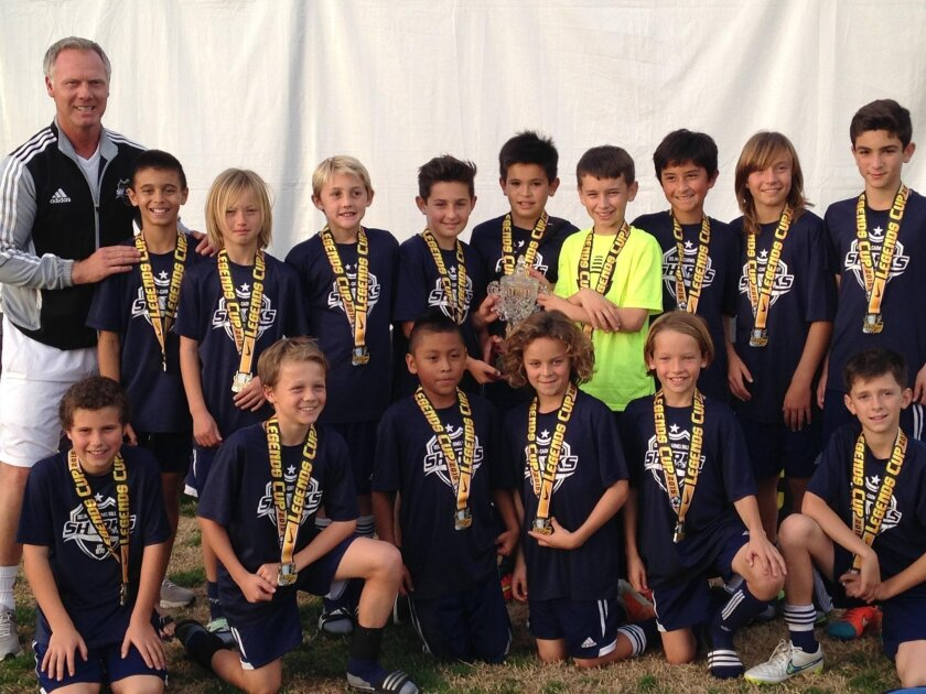 The DMCV Sharks BU11 team, coached by Warren Barton, went undefeated in the 2015 Legends Cup Tournament winning all four of their games.