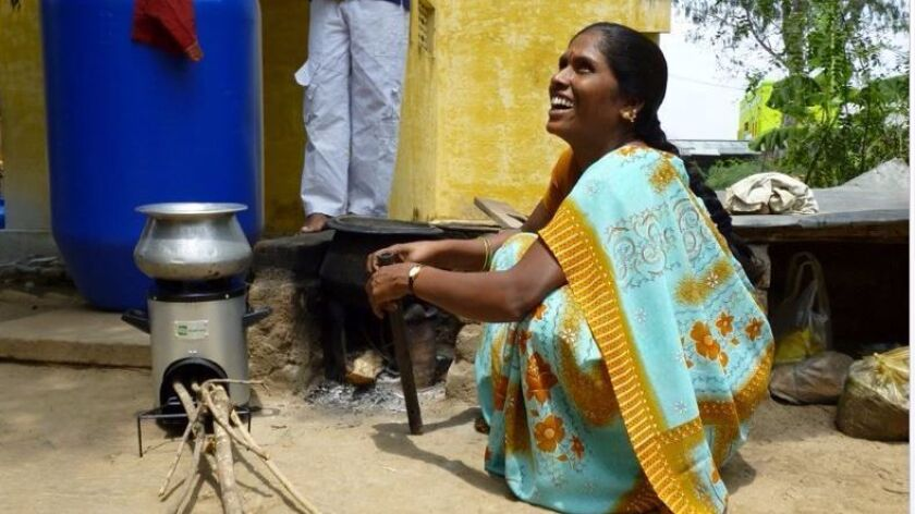 A woman from India uses a power stove.
