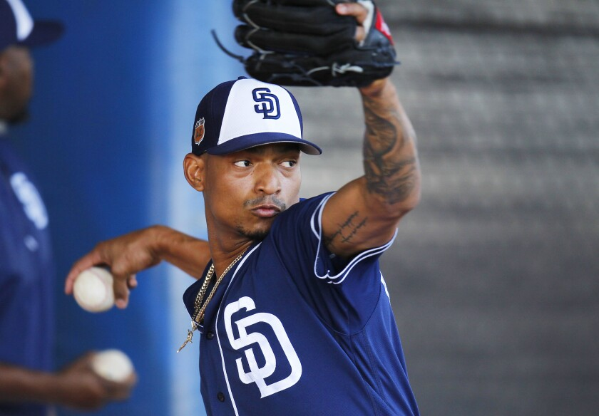San Diego Padres catcher Christian Bethancourt pitches during a spring training practice.