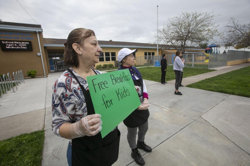 Elia Perez, food services manager, at Harborside Elementary in Chula Vista, the first day schools closed