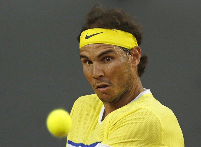Rafael Nadal of Spain returns the ball to Nicolas Almagro of Spain, during a Rio Open tennis match, in Rio de Janeiro, Brazil, Thursday, Feb. 18, 2016. (AP Photo/Silvia Izquierdo)