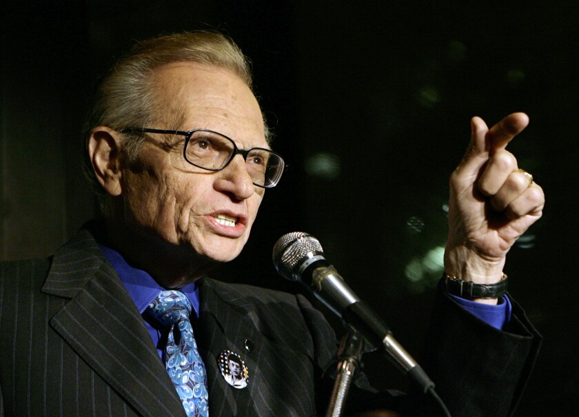 FILE - In this April 18, 2007 file photo, Larry King speaks to guests at a party held by CNN