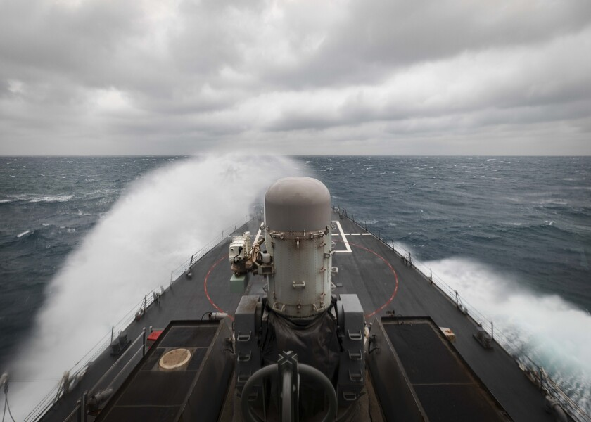 """In this photo provided by the U.S. Navy, the guided-missile destroyer USS John S. McCain conducts routine underway operations in support of stability and security for a free and open Indo-Pacific, at the Taiwan Strait, Wednesday, Dec. 30, 2020. China accused the U.S. of staging a show of force by sailing two Navy warships through the Taiwan Strait on Thursday morning. The Navy said the Arleigh Burke-class guided missile destroyers USS John S. McCain and USS Curtis Wilbur """"conducted a routine Taiwan Strait transit"""" in accordance with international law.(Mass Communication Specialist 2nd Class Markus Castaneda/U.S. Navy via AP)"""