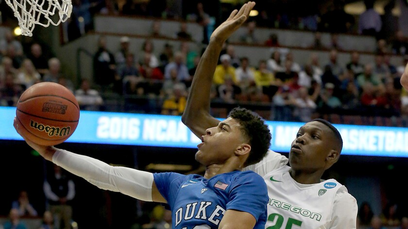 Duke guard Derryck Thornton Jr. drives past Oregon forward Dillon Brooks for a layup in the first half of the NCAA Tournament West Regional game on March 24.
