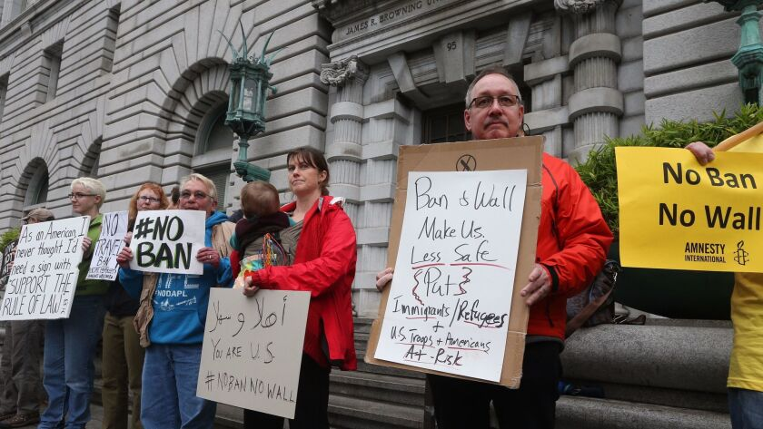 Opponents of President Trump's travel ban on seven Muslim-majority nations protest outside the federal appeals court in San Francisco on Feb. 7.