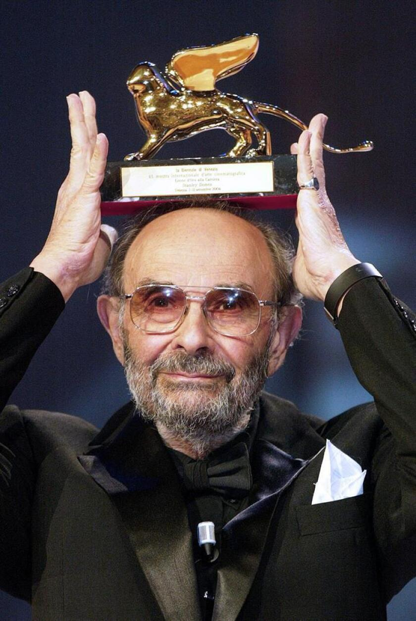 American filmmaker Stanley Donen poses with the Golden Lion for Lifetime Achievement Award he received at the 61st annual Venice International Film Festival in Venice, Italy, on Sept. 11, 2004 (reissued on Feb. 21, 2019). Donen died on Feb. 21, 2019, at the age of 94, according to multiple US media reports. EPA-EFE/CLAUDIO ONORATI