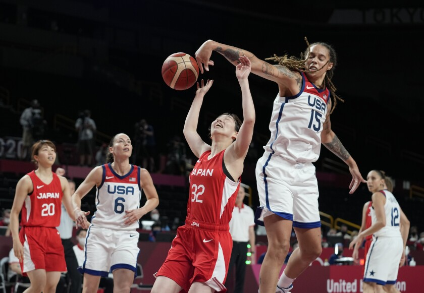 Japan's Saori Miyazaki (32), center, is blocked by United States' Brittney Griner (15), second right, during women's basketball preliminary round game at the 2020 Summer Olympics, Friday, July 30, 2021, in Saitama, Japan. (AP Photo/Eric Gay)