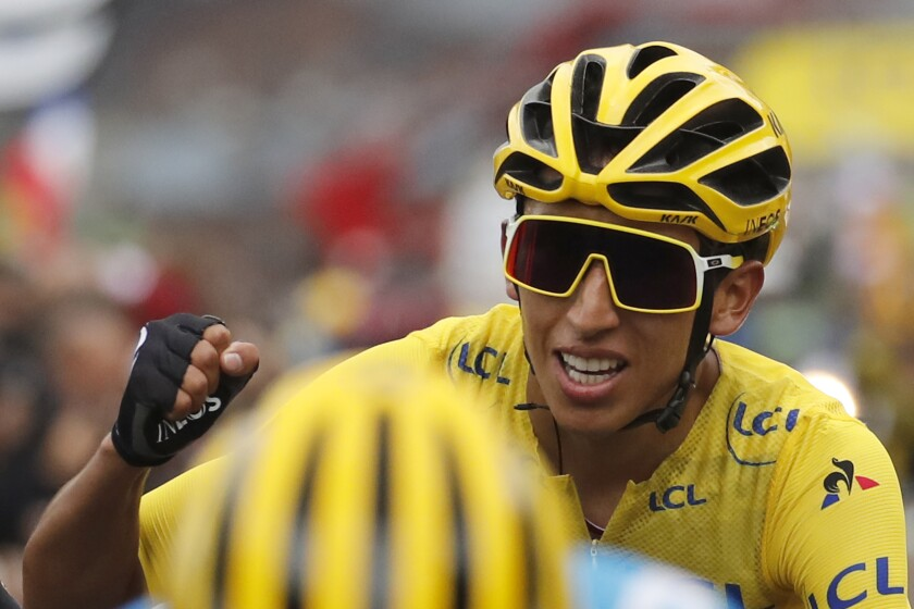 Cyclist Egan Bernal wears the yellow jersey as he crosses the finish line of Stage 20 of the Tour de France.