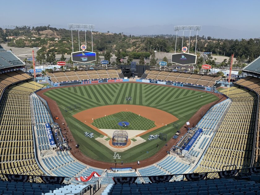 Dodger Stadium workers prep the field for Game 5 of the NLDS on Oct. 9, 2019.