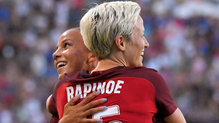 United States' Megan Rapinoe, front, celebrates her goal with Mallory Pugh during the first half aga