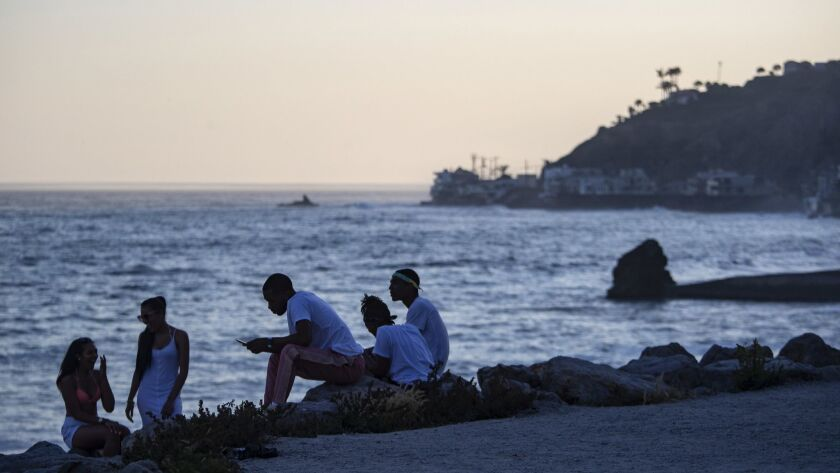 MALIBU, CALIF. -- FRIDAY, JULY 6, 2018: Young people enjoy early evening temperatures in the mid-80s