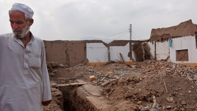 Shah Khan Kukikhel among the rubble of his brother's home near Jamrud, in the tribal areas.